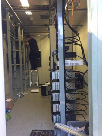 Field tech working up a ladder